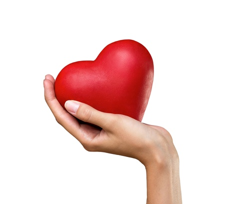 woman's hand: red heart in womans hand isolated on white background