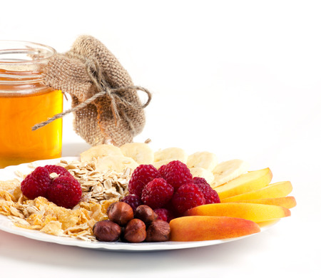 vitamins breakfast - muesli with berry, fruits, nuts and honey on white background Stock Photo - 22759081