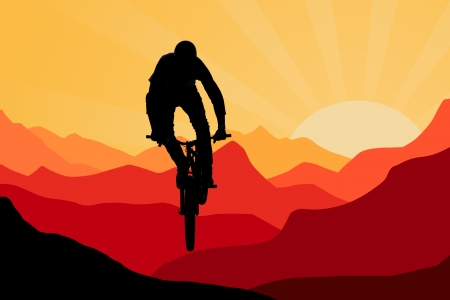 mountainbike: biker on bicycle jamping on sunrise and mountains  background, sihouette Stock Photo