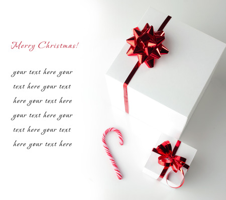 christmas card with gift white boxes and candycane on white background photo