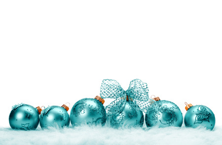 A row of turquoise Christmas balls in fur on white background photo