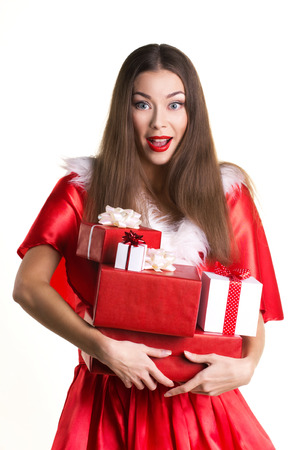 costum: emotional beautiful adult girl in red costum of santa with present boxes on white background