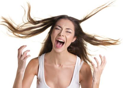 탱크 탑: portrait of a screaming young woman in white tank top with long flying hear on white background