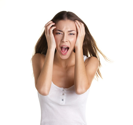 hysterical: portrait of a beautiful crying young woman with long hear, in white tank top, on white background
