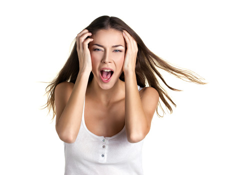 hysterical: portrait of a beautiful screaming young woman with long flying hear on white background Stock Photo