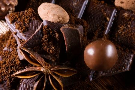 badiane: chocolate assorttment with cinamon and badiane on wooden table