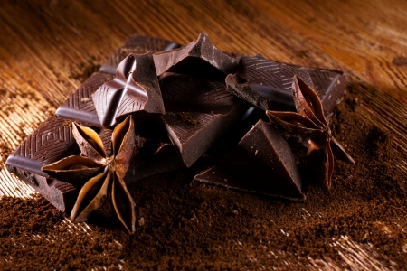 badiane: chocolate path with spices - badiane and cinamon on wooden table