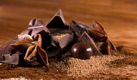 badiane: path chocolate and ball bonbon with cinamon and badiane on wooden table Stock Photo