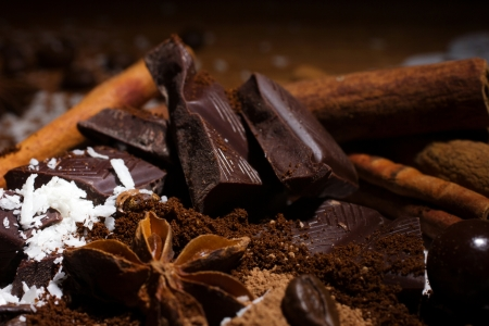 badiane: close up of slices chocolate, candy, coffee beans and ground coffee, anise and cinnamon