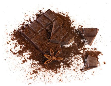 badiane: chocolate brick and path with spices - badiane and cinamon on white background