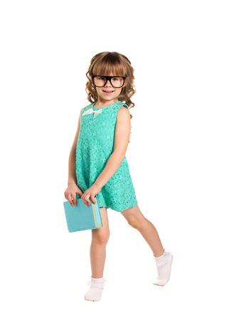 little beautiful girl with long blond curls in fashion green dress with glasses and book isolated on white photo