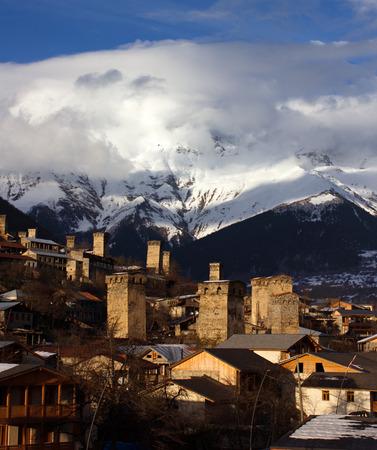 sunny svan towers in Mestia in winter. caucasus, Svaneti, Georgia photo
