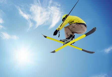 jumping skier  on blue sky background Standard-Bild