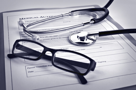 grayscale:  Medical authorization form,  glasses and   stethoscope Stock Photo