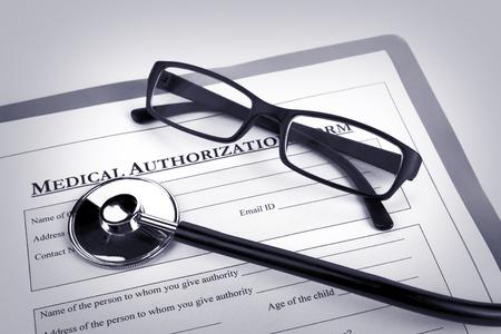 authorization:    Medical authorization form, optical glasses and   stethoscope