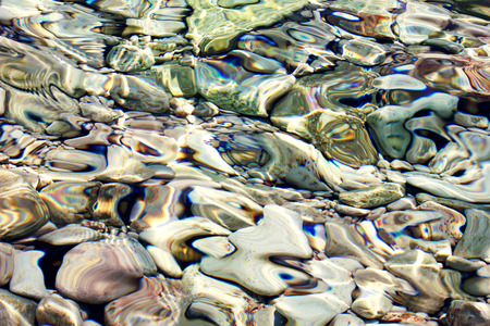 sea colorful stones under water,  abstract marine background  photo