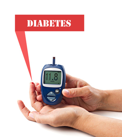 diagnosed: diabetic concept -  elderly womans hands, glucometer and  red warning about high level sugar in blood Stock Photo