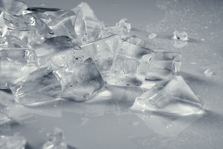 misted: pile of crushed transparent  ice on misted light  grey surface Stock Photo