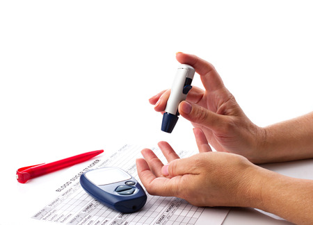 blood glucose: diabetic concept - womans hands, glucometer, medicine form and pen on white background with place for your text