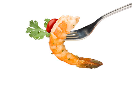 A close up of a tasty shrimp appetizer with grape tomato and parsley in a fork on white background photo