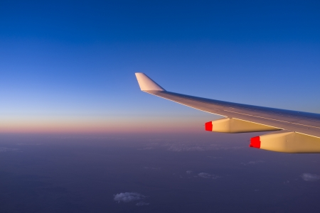 Sunset over the horizon from airplane cabin Stock Photo