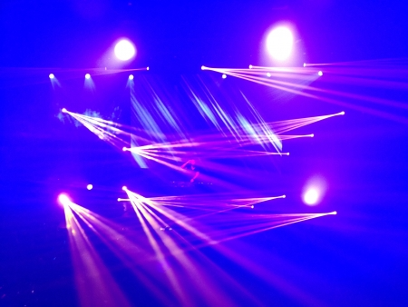 laser lights: Bright laser lights at a rave party Stock Photo