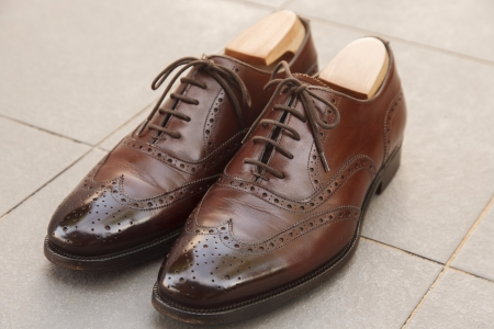 brogues: A pair of highly polished brown brogue shoes