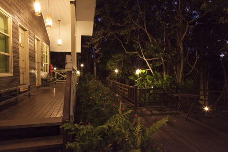 enclosures: A chalet in the enclosures of nature in the evening Stock Photo
