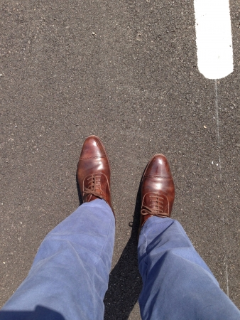pants: Blue chinos and brown leather cap toe shoes