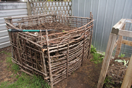 composting: Backyard compost bin built from natural materials Stock Photo