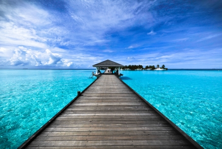 Wooden walkway on the sea in the Maldives