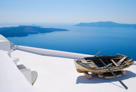 Abandoned boat on top of a roof in Santorini, Greek Islands