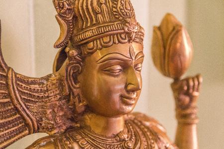 shiva brass - gold color statue close up