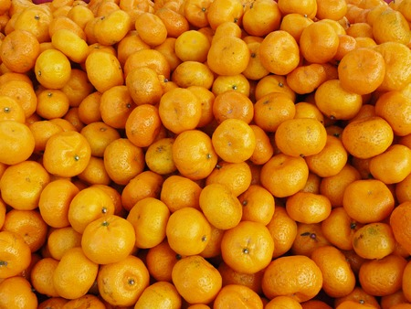 The group of Chinese small oranges, Many fresh fruit close up background.