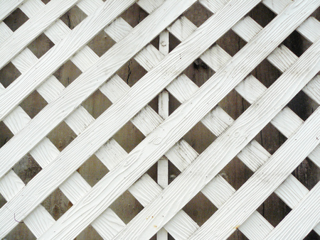 latticework: Close up the white wood of lath wall, background and texture.white Stock Photo