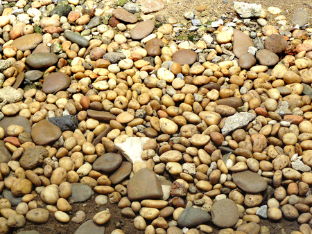The gravel stone floor texture background,The Dust Texture. Abstract dense splash texture. Random pebble gravel oval elements seamless pattern.