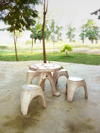 round chairs: Stone round chairs and round table of relaxing corner in the park.