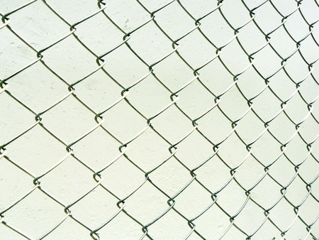 Perspective of wire mesh fence. Repeating chain link fence white metal wire mesh or metal net repeats left, right, up and down. The wire mesh fence pattern texture isolate on white background. Stock Photo