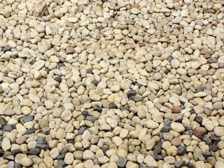 砂利石の床の塵テクスチャ テクスチャ背景。密なスプラッシュ テクスチャを抽象化します。ランダムな小石砂利楕円要素シームレス パターン。 写真素材