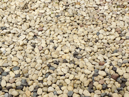 The gravel stone  floor texture background,The Dust Texture. Abstract dense splash texture. Random pebble gravel oval elements seamless pattern. Imagens