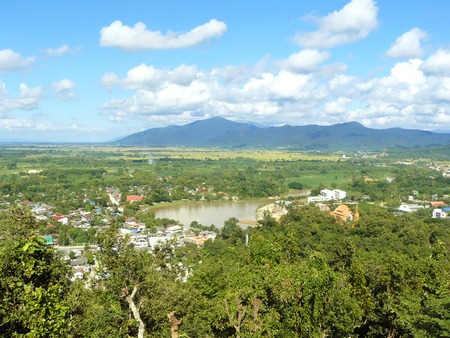 Landscape of village in the valley and beautiful blue sky with fluffy white clouds in a sunny day. Chiangrai province, Thailand. Stock Photo