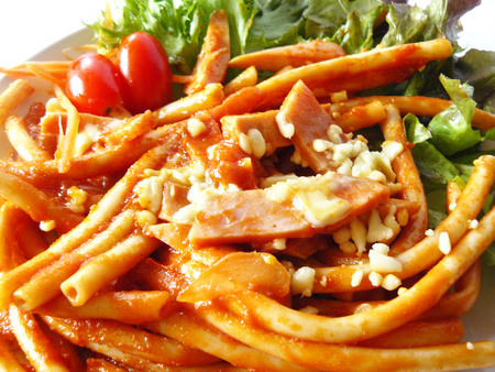 Thai Italian fusion food mix, Stir fried macaroni with ketchup and shrimps served with green vegetable like a lettuce and etc.