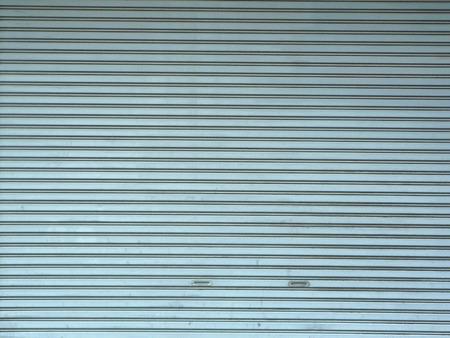 aluminum: A photo of aluminium steel metal roller shutter door for background.