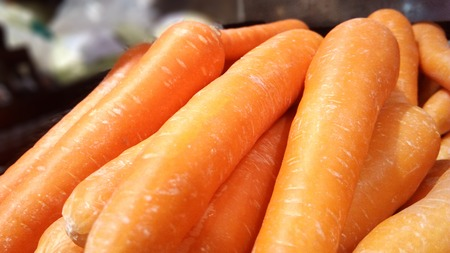 Vegetable for healthy diet food. A photo of group of orange carrot (Daucus carota L.) is very fresh vegetable, close up for background.