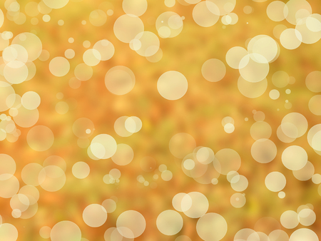 Abstract of light on yellowish - brown background of natural Bokeh circles.