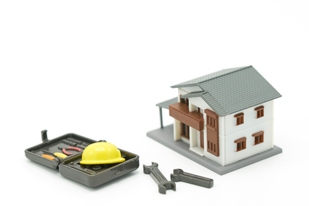 House Models and Equipment Models There are yellow construction helmet models. Home Repair and Construction . as background property real estate concept with copy space for your text or  design. Stock Photo