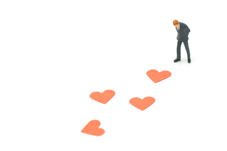 Miniature people businessmen Find the heart to fall by the way. as background Valentine concept with copy spaces for your text or design. Stock Photo