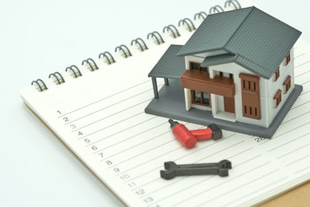 House Models and Equipment Models placed on a Book Rankings (list). Home Repair and Construction . using as background property real estate concept with copy space for your text or design. Stock Photo