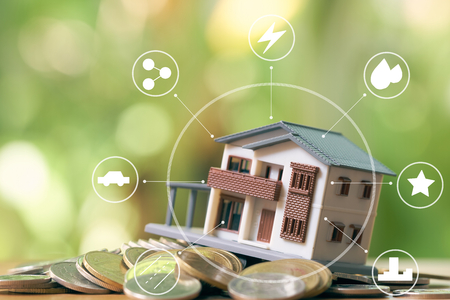 Infographics of A model house model is placed on a pile of coins.using as background business concept and real estate concept with copy space for your text or design. Stock Photo