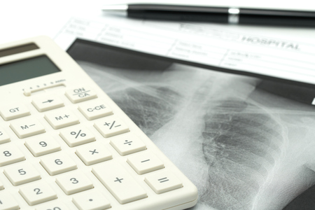 white calculator with Lung x-ray .using as background Healthcare concept and Medical concept with copy space and white space.